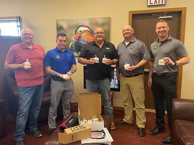 Minot Hometown Radio Team with ARNG Recruiters and custom cookies